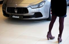 Put down the Maserati keys: Britons are more likely to rejoice in the health of their bank balance than the size of their house or car. REUTERS/Kim Hong-Ji