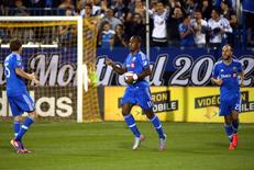 Montreal Impact forward Didier Drogba (11) celebrates his goal against Chicago Fire with teammate midfielder Justin Mapp (21) during the second half at the Sade Saputo. Jean-Yves Ahern-USA TODAY Sports