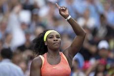 Serena Williams of the U.S. makes a sign towards fans after defeating compatriot Madison Keys in their fourth round match at the U.S. Open Championships tennis tournament in New York, September 6, 2015. REUTERS/Carlo Allegri