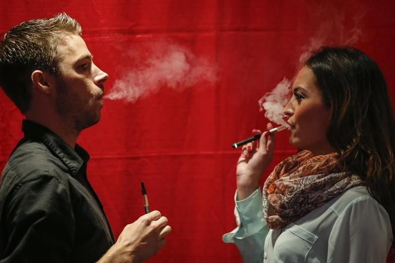 People use electronic vaporizers with cannabidiol (CBD)-rich hemp oil while attending the International Cannabis Association Convention in New York, in this October 12, 2014 file photo. REUTERS/Eduardo Munoz