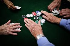 Retirees play poker at a singles club in Sun City, Arizona, in this January 4, 2013 file photo. REUTERS/Lucy Nicholson