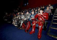 "A group of fans dressed in homemade replica armour of ""Avengers: Age of Ultron"" movie characters, Iron Man, Captain America and Thor, watch the film in a theatre in Changchun, Jilin province, China, May 16, 2015. REUTERS/Stringer"