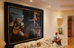 A painting former TV star and teen idol David Cassidy commissioned showing him serenading his young family while on horseback hangs in a living room of the 7,000 square-foot, five-bedroom waterfront house that is up for auction in Fort Lauderdale, Florida, August 26, 2015.  REUTERS/Zachary Fagenson