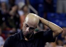 James Blake of the U.S. reacts after losing to Ivo Karlovic of Croatia at the U.S. Open tennis championships in New York in this August 28, 2013 file photo. REUTERS/Shannon Stapleton