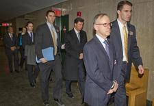 Law firm Dewey and Leboeuf's ex-Chairman Steven Davis (2nd R), ex-CFO Joel Sanders (3rd R), former executive director Stephen DiCarmine and former client relations manager Zachary Warren arrive in handcuffs at Manhattan Criminal Court in New York March 6, 2014. REUTERS/Carlo Allegri