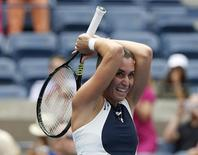 Flavia Pennetta of Italy reacts after defeating Simona Halep of Romania in their women's singles semi-final match at the U.S. Open Championships tennis tournament in New York, September 11, 2015. REUTERS/Shannon Stapleton
