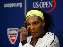 Serena Williams of the U.S. listens to a reporter's question during a post-match press conference following her loss to Roberta Vinci of Italy in their women's singles semi-final match at the U.S. Open Championships tennis tournament in New York, September 11, 2015.  REUTERS/Shannon Stapleton