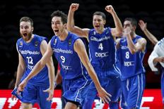 Czech Republic's David Jelinek (12), Jiri Welsch (9), Petr Benda (4) and Tomas Satoransky (8) celebrate their victory in the EuroBasket 2015 round of 16 match against Croatia at the Pierre Mauroy stadium in Villeneuve d'Ascq near Lille, France, September 13, 2015. REUTERS/Benoit Tessier