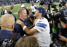 Sep 13, 2015; Arlington, TX, USA; Dallas Cowboys quarterback Tony Romo (9) celebrates a victory with head coach Jason Garrett after the game against the New York Giants at AT&T Stadium. Mandatory Credit: Matthew Emmons-USA TODAY Sports