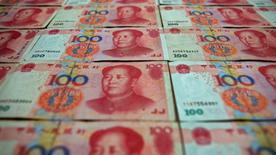Les autorités chinoises ont saisi jusqu'à 1.000 milliards de yuans (138 milliards d'euros) auprès d'autorités régionales n'ayant pas dépensé le budget qui leur avait été alloué, selon des sources proches du gouvernement. La somme de 1.000 milliards de yuans représente environ 6% de la totalité des dépenses publiques prévues cette année. /Photo d'archives/REUTERS/Petar Kujundzic