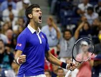 Novak Djokovic celebrates in the fourth set against Roger Federer during their men's singles final match at the U.S. Open Championships tennis tournament in New York, September 13, 2015.  REUTERS/Shannon Stapleton