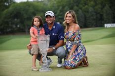 Aug 30, 2015; Edison, NJ, USA; Jason Day, along with his son Dash and his wife Ellie, pose with the Barclays Championship trophy at Plainfield Country Club. Mandatory Credit: Eric Sucar-USA TODAY Sports