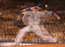 Sep 15, 2015; Pittsburgh, PA, USA; (Editors note: Multiple exposure image) Chicago Cubs starting pitcher Jon Lester (34) pitches against the Pittsburgh Pirates during the sixth inning at PNC Park. Mandatory Credit: Charles LeClaire-USA TODAY Sports
