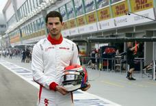 Manor Marussia Formula One driver Alexander Rossi of the U.S. poses in pit lane at the Marina Bay street circuit ahead of the first practice session of the Singapore F1 Grand Prix September 18, 2015. REUTERS/Edgar Su