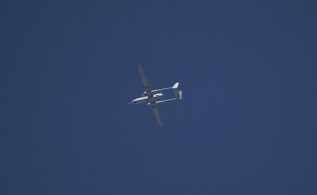 An Israeli drone flies over the West Bank city of Hebron in this June 14, 2014 file photo. REUTERS/Ronen Zvulun/Files