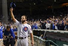 Sep 22, 2015; Chicago, IL, USA; Chicago Cubs starting pitcher Jake Arrieta (49) waves to the crowd after beating the Milwaukee Brewers 4-0 at Wrigley Field. Mandatory Credit: Matt Marton-USA TODAY Sports