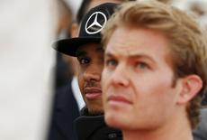 Mercedes Formula One drivers Lewis Hamilton (L) of Britain and Nico Rosberg of Germany attend the unveiling ceremony of a monument in Suzuka, Japan, September 24, 2015, ahead of Sunday's Japanese F1 Grand Prix. REUTERS/Thomas Peter -