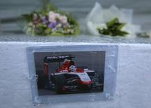 A photo of late Marussia Formula One driver Jules Bianchi of France, who died nine months after his crash at Japanese Grand Prix in 2014 and without regaining consciousness, and flowers are offered at a stand especially set up beside a track at Suzuka Circuit in Suzuka, Japan, September 24, 2015, ahead of Sunday's Japanese F1 Grand Prix. REUTERS/Toru Hanai