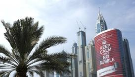 "An advertising sign for a real estate company reading ""Keep Calm There's no Bubble"" is seen on a building in the Marina district of Dubai November 19, 2013. REUTERS/Caren Firouz"