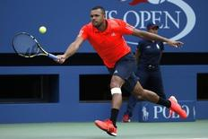 Jo-Wilfried Tsonga of France returns a shot to Marin Cilic of Croatia during their quarterfinals match at the U.S. Open Championships tennis tournament in New York, September 8, 2015.    REUTERS/Mike Segar