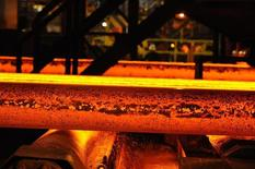 A steel slab is cooled with water on the roller table at the SSI steel plant at Redcar, northern England May 29, 2012.  REUTERS/Nigel Roddis