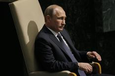 Russian President Vladimir Putin waits to address attendees during the 70th session of the United Nations General Assembly at the U.N. Headquarters in New York, September 28, 2015.   REUTERS/Carlo Allegri