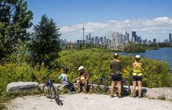 People look out at the Toronto skyline from Tommy Thompson Park located on a man-made peninsula known as the Leslie Street Spit, in Toronto August 9, 2015. REUTERS/Mark Blinch