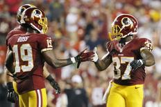 Washington Redskins running back Mack Brown (37) celebrates with Redskins wide receiver Rashad Ross (19) after scoring a touchdown in the fourth quarter against the Jacksonville Jaguars at FedEx Field. The Jaguars won 17-16. Mandatory Credit: Amber Searls-USA TODAY Sports