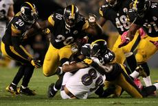Oct 1, 2015; Pittsburgh, PA, USA; Pittsburgh Steelers linebacker Lawrence Timmons (94) tackles Baltimore Ravens wide receiver Steve Smith Sr (89) during the second half at Heinz Field. The Ravens won the game, 23-20 in overtime. Mandatory Credit: Jason Bridge-USA TODAY Sports