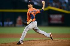 Oct 3, 2015; Phoenix, AZ, USA; Houston Astros starting pitcher Collin McHugh (31) pitches during the third inning against the Arizona Diamondbacks at Chase Field. Mandatory Credit: Joe Camporeale-USA TODAY Sports