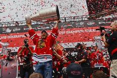 JChicago Blackhawks defenseman Kimmo Timonen (44) holds the Stanley Cup up during the 2015 Stanley Cup championship rally at Soldier Field. Mandatory Credit: Matt Marton-USA TODAY Sports - RTX1H5DV