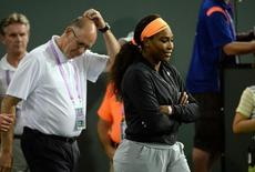Mar 20, 2015; Indian Wells, CA, USA; Serena Williams (USA) is followed by tournament director Steve Simon as she walks onto the court to talk to the crowd announcing her withdrawal due to knee injury.Jayne Kamin-Oncea-USA TODAY Sports