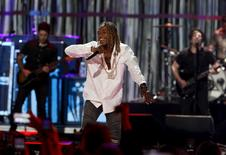 Fetty Wap (C) performs with Fall Out Boy during the second night of the 2015 iHeartRadio Music Festival at the MGM Grand Garden Arena in Las Vegas, Nevada September 19, 2015. REUTERS/Steve Marcus