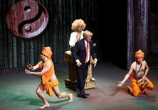 "Mexican comics, one of them dressed as U.S. Republican presidential candidate Donald Trump (front C), poke fun at the candidate during the show entitled ""Sons of Trump"" at the Aldana theater in Mexico City, Mexico October 3, 2015.  REUTERS/Henry Romero"