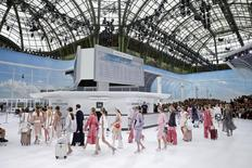 Models present creations by German designer Karl Lagerfeld as part of his Spring/Summer 2016 women's ready-to-wear collection for fashion house Chanel at the Grand Palais which is transformed into a Chanel airport during Fashion Week in Paris, France, October 6, 2015. REUTERS/Benoit Tessier