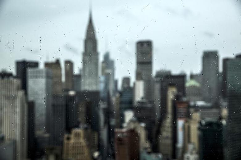 Midtown Manhattan is seen through a window in Manhattan, New York, October 2, 2015.   REUTERS/Andrew Kelly