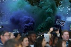 "Demonstrators let off flares in the crowd during the Gala screening of the film ""Suffragette"" for the opening night of the British Film Institute (BFI) Film Festival at Leicester Square in London October 7, 2015.  REUTERS/Luke MacGregor"