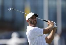 U.S. team member Dustin Johnson watches his tee shot on the fifth hole during the opening foursome matches of the 2015 Presidents Cup golf tournament at the Jack Nicklaus Golf Club in Incheon, South Korea, October 8, 2015.  REUTERS/Kim Hong-Ji