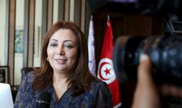 Wided Bouchamaoui, president of Tunisia's Employers' Organisation (UTICA) and a member of Tunisia's National Dialogue Quartet, talks to journalists in her office in Tunis, Tunisia October 9, 2015. REUTERS/Zoubeir Souissi