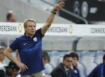 U.S. national soccer team coach Juergen Klinsmann gestures during their international friendly soccer match against Germany in Cologne, Germany June 10, 2015.  REUTERS/Ina Fassbender