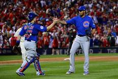 Oct 10, 2015; St. Louis, MO, USA; Chicago Cubs catcher Miguel Montero (left) celebrates with relief pitcher Hector Rondon (right) after game two of the NLDS against the St. Louis Cardinals at Busch Stadium. Mandatory Credit: Jeff Curry-USA TODAY Sports