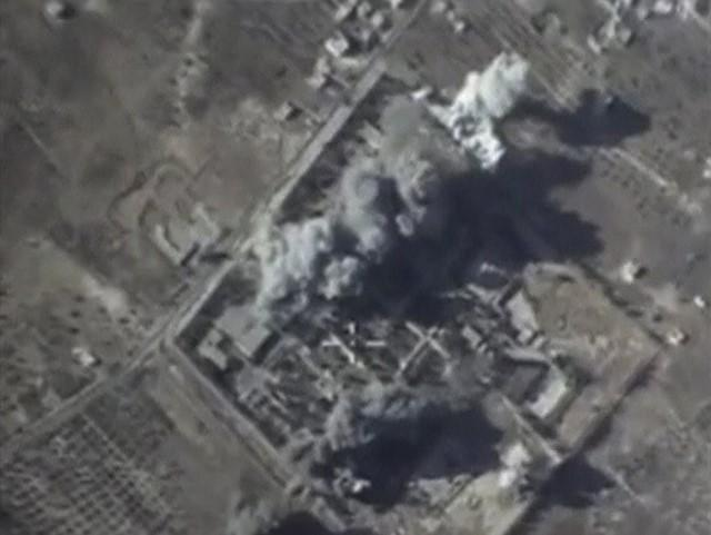 A frame grab taken from footage released by Russia's Defence Ministry October 12, 2015, shows what Russia says is smoke rising after air strikes carried out by the Russian air force on an Islamic State training camp in Idlib province, Syria.  REUTERS/Ministry of Defence of the Russian Federation/Handout via Reuters