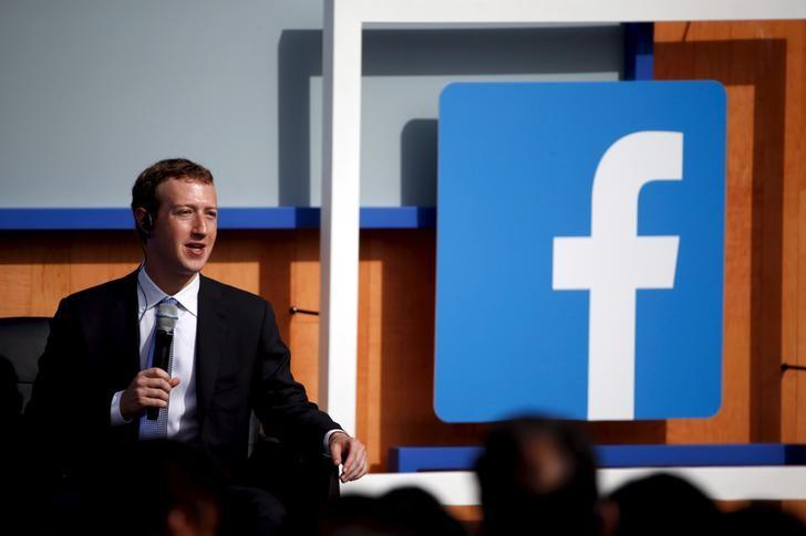 Facebook CEO Mark Zuckerberg speaks on stage during a town hall with Indian Prime Minister Narendra Modi at Facebook's headquarters in Menlo Park, California September 27, 2015. REUTERS/Stephen Lam