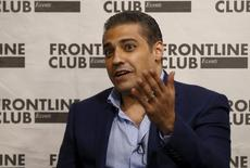 Canadian journalist Mohamed Fahmy, who was recently freed from jail in Egypt, talks to an audience at an event at the Frontline Club in London, Britain, October 7, 2015.  REUTERS/Peter Nicholls
