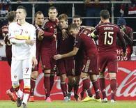 Russia's Aleksandr Kokorin (4th R) celebrates his goal with team mates (R-L) Roman Shirokov, Igor Denisov, Alan Dzagoev, Artem Dzyuba, Sergei Ignashevich and Dmitri Kombarov during their Euro 2016 group G qualifying soccer match against Montenegro at the Otkrytie Arena stadium in Moscow, Russia, October 12, 2015. REUTERS/Sergei Karpukhin