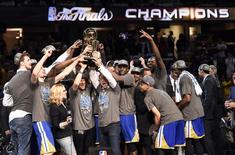 Jun 16, 2015; Cleveland, OH, USA; The Golden State Warriors celebrate with the Larry O'Brian Trophy after beating the Cleveland Cavaliers in game six of the NBA Finals at Quicken Loans Arena. Mandatory Credit: Bob Donnan-USA TODAY Sports