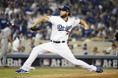 October 9, 2015; Los Angeles, CA, USA; Los Angeles Dodgers starting pitcher Clayton Kershaw (22) pitches the first inning against the New York Mets in game one of the NLDS at Dodger Stadium. Mandatory Credit: Richard Mackson-USA TODAY Sports