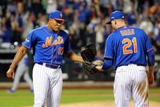 New York Mets first baseman Lucas Duda (21) and relief pitcher Jeurys Familia (27) celebrates after beating the Los Angeles Dodgers in game three of the NLDS at Citi Field. Mandatory Credit: Anthony Gruppuso-USA TODAY Sports