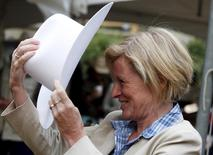 Alberta Premier Rachel Notley tries on her new Smithbilt cowboy hat after being white hatted at her premier's pancake breakfast during the Calgary Stampede in Calgary, Alberta, July 6, 2015. REUTERS/Todd Korol