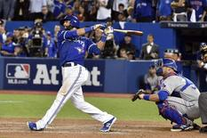 Oct 14, 2015; Toronto, Ontario, CAN; Toronto Blue Jays right fielder Jose Bautista (19) hits a home run during the seventh inning against the Texas Rangers in game five of the ALDS at Rogers Centre. Mandatory Credit: Nick Turchiaro-USA TODAY Sports
